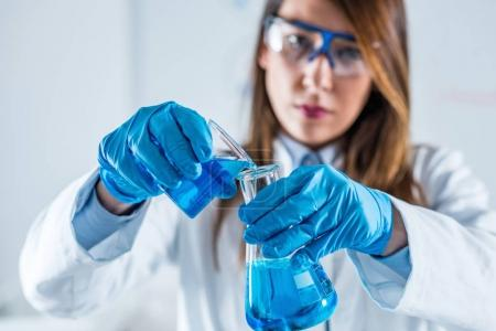 Photo for Biotechnology. Female scientist working in laboratory - Royalty Free Image
