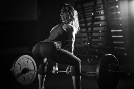 Woman weightlifting on training in the gym