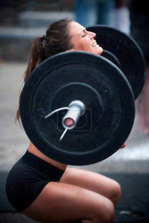 Cross training fitness, woman lifting weights