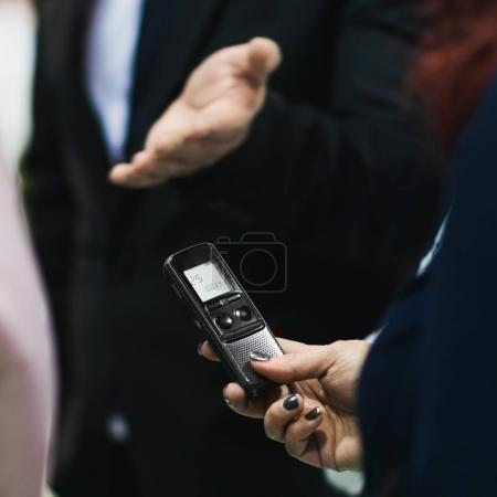 Interviewing politician. Businesswoman using phone