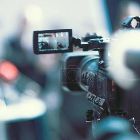 close up of Camera at a media conference