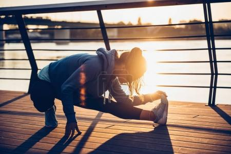 Woman streching by the river