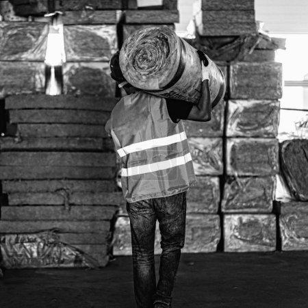 Manual Worker carring steer wood