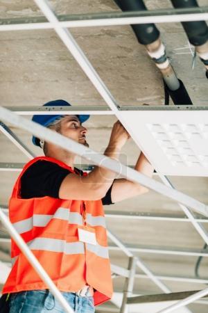 Installation worker on construction site working