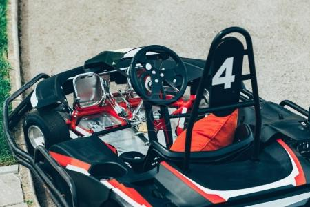 close up of  go-cart on a sports track