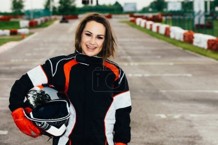 Woman holding safety helmet at on a sports track