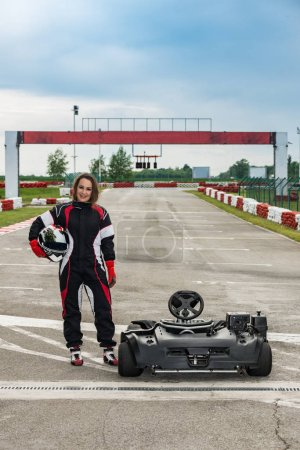 Woman standing at  go-cart on a sports track