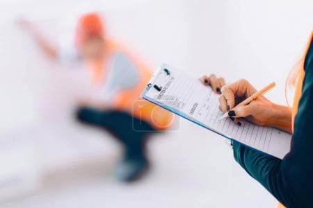 close up of Architect with checking list