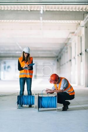 Maintenance Engineers checking cables