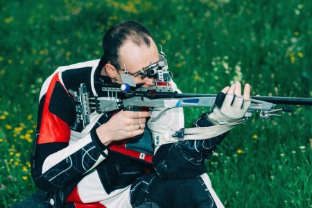 Man practicing for competition sport shooting with free rifle