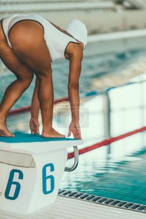 Female on Start position on  pool side