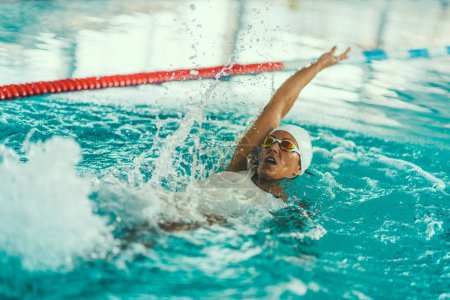 Photo for Female swimmer on training in the swimming pool. Backstroke swimming style - Royalty Free Image