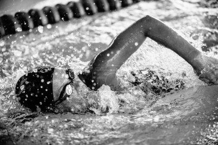 Female swimming in swimming lanes