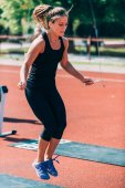 Female jumping rope on crossfit competition