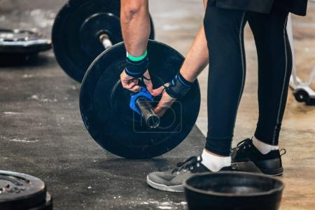 Photo for Athlete Changing weights at Weightlifting competition - Royalty Free Image
