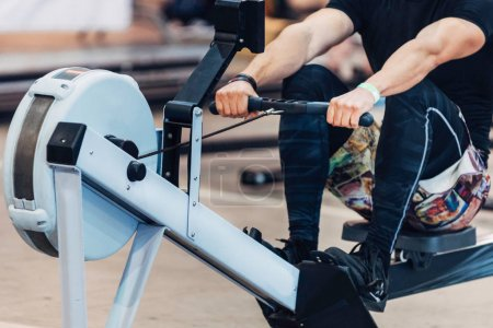 Rowing machine competitor on crossfit