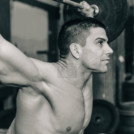 Photo for Male athlete on weightlifting training - Royalty Free Image