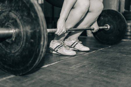 Female on weightlifting training in the gym