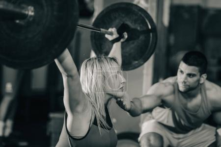 female amd male at Weightlifting training