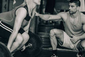 female and male at Weightlifting training