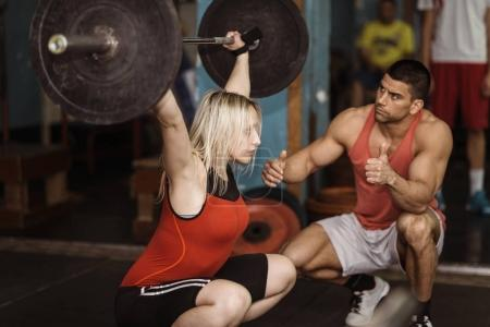 male and female at Weightlifting training