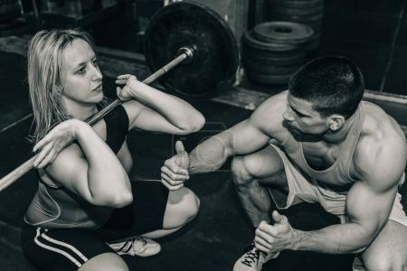 Female and male on weightlifting training