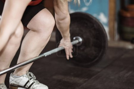 Female athlete on weightlifting training