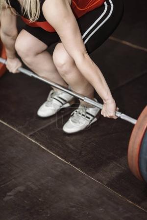 Female athlete on weightlifting training