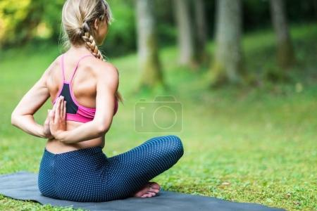 woman sitting in  Prayer Position