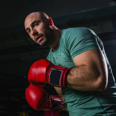 Man on boxing training in the ring