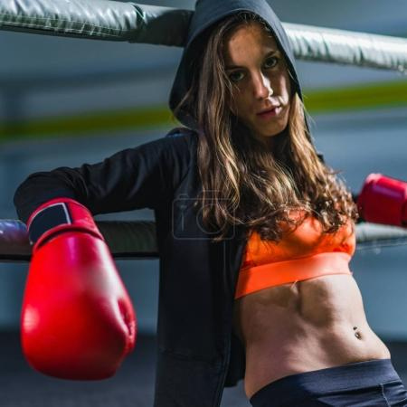 Woman on boxing training in the ring