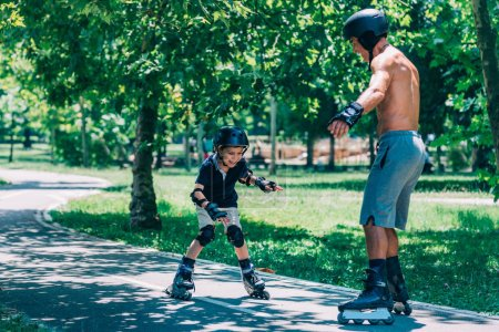 Grandfather and grandson spending quality time, roller skating