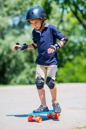 Photo for Little boy with skateboard - Royalty Free Image