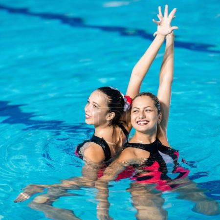 Synchronized Swimmers dancing in the pool