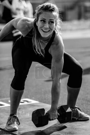 Woman with weights on cross competition