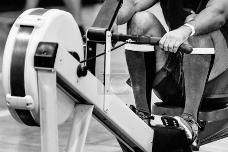 athlete on rowing machine on crossfit training