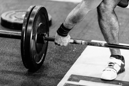 Photo for Crossfit competitor picking up weights - Royalty Free Image