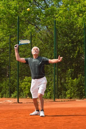 Active senior playing tennis