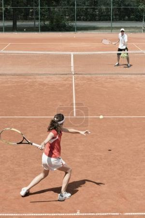 Junior female on tennis class