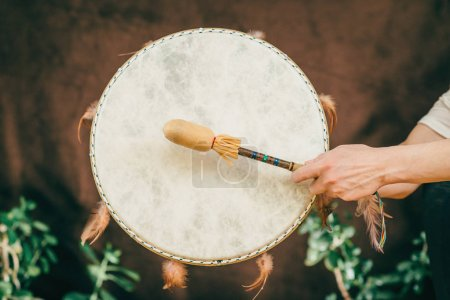 woman hands holding Indian drum in sound therapy