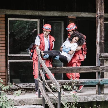 Rescue team evacuating disaster victim