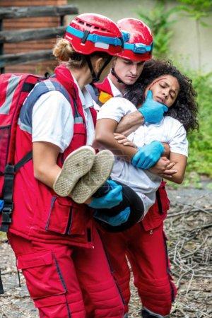 Rescue team evacuate female victim from house
