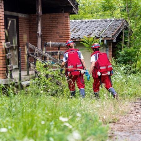 Rescue team helping injured female victim