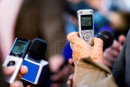 Dictaphones recording interview with politician