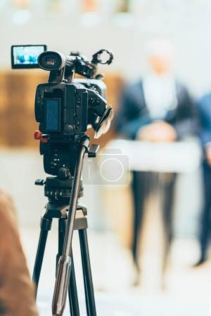 Television camera recording publicity event