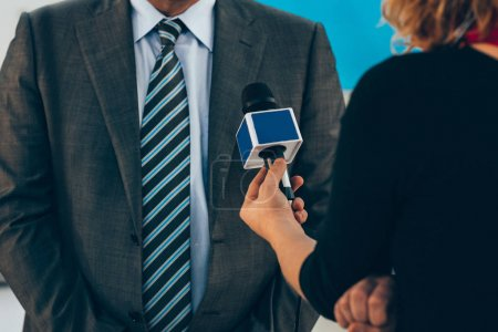 Journalist interviewing business person on public event