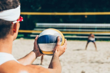 Beach volleyball Player holding ball