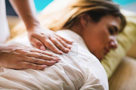 Photo for Reiki Therapist Balancing Chakras. Energy Healing Concept. - Royalty Free Image