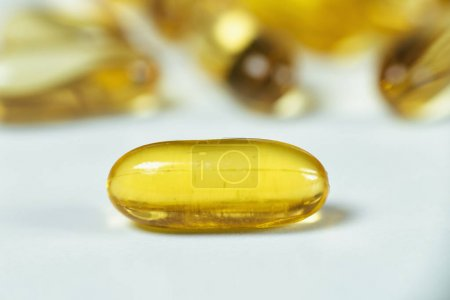 Photo for Omega 3 supplements.  Softgel supplement capsules, close up - Royalty Free Image