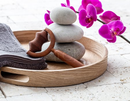 ayurveda and mindfulness for calming body massage over balancing stones